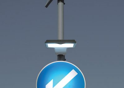 lit up blue solar powered road sign with arrow